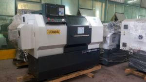 Heavy Duty CNC Lathe with Auto Bar Feeder (JD40A/CK6140) pictures & photos
