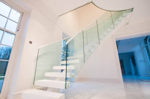 Simple Design Wooden Staircase with Glass Railing pictures & photos