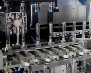600ml 4cavity Pet Bottle Full Automatic Stretch Blow Molding Machine pictures & photos
