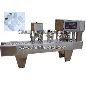 Milk Bottle Filling Lid Sealing Machine pictures & photos