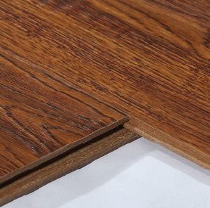 Emboss Waterproof Laminate/Laminated Flooring with Waxed pictures & photos