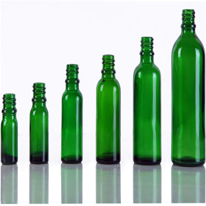Tall Glass Bottles with Caps pictures & photos