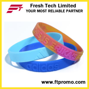 Fashion OEM Silicone Wristband with Embossed Logo pictures & photos