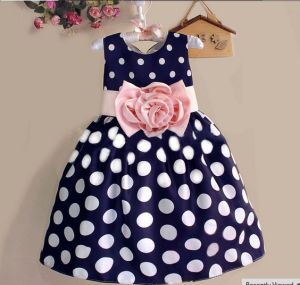 Fashion Sweet Polka DOT Kids Flower Girls Dress Children Wear pictures & photos
