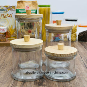 Factory Wholesale High Quality Nature Wood Lid Food Candy Storage Glass Jar (200018) pictures & photos