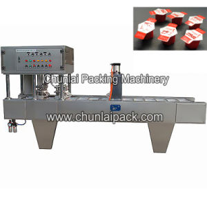 Cosmetic Pot Filling Sealing Machine pictures & photos