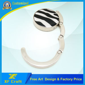 Custom Promotion Purse Hook Foldable Fashion Table Top Metal Handbag/Bag Hanger for Promotional Gift (XF-pH01) pictures & photos