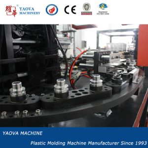 Pet Candy Bottles Hand Feed Automatic Stretch Blow Moulding Machine pictures & photos