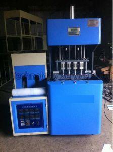 4-Cavity Semi-Auto Plastic Pet Bottle Blow Molding Machine pictures & photos