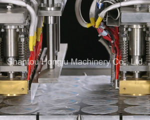 Rotary Type Filling and Sealing Machine for Yogurt Cup pictures & photos
