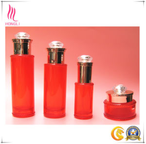Red Round Glass Packaging with Diamond on The Aluminum Lid pictures & photos