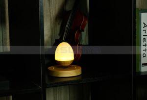 Mini Wood HiFi Wireless LED Bulb Floating Speakers Bluetooth Maglev Wood Speaker pictures & photos