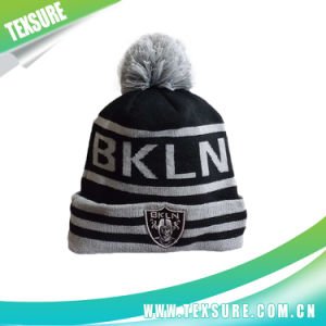 Promotional Jacquard Acrylic Beanie Knitted Hat with Pompom Ball (115) pictures & photos