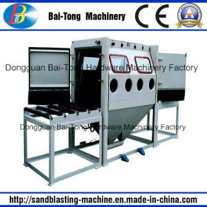 Double Work Position Manual Roller Conveyer Sandblasting Machine pictures & photos