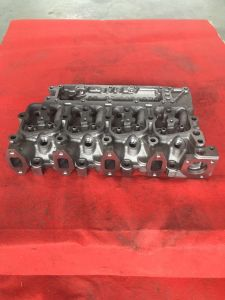 Cumins Auto Engine Spare Parts Cylinder Head with Best Price 4bt pictures & photos
