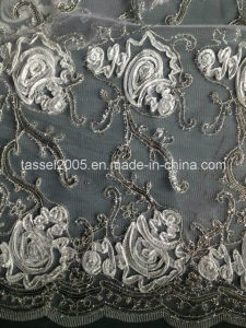 Most Popular Peacock Sequin Embroidery Fabric on Mesh Ground pictures & photos
