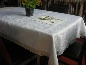 100%Polyester Solid Jacquard Tablecloth with Lace pictures & photos