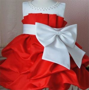 Girls Dress Sleeveless Big Bow Decorative Stitching Pearl Dress Princess Dress pictures & photos