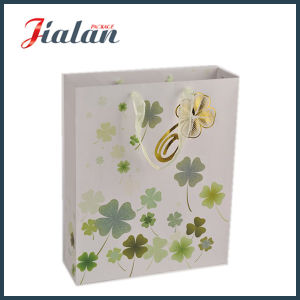 Four Leaf Clovers Printed & Hot Stamping Shopping Gift Paper Bag pictures & photos