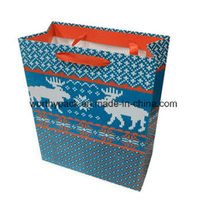 Glossy Blue Cmyk Printing Art Paper Bag with Ribbon Handle pictures & photos