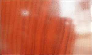 German 8mm Waterproof Glossy Brazilian Cherry Laminate Wood Flooring pictures & photos