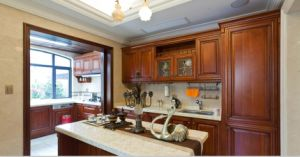 2017 New Design Brown Solid Wood Kitchen Cabinet Yb-1706013 pictures & photos