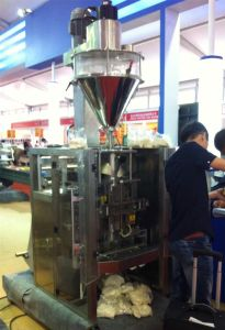 Pouch Packing Machine for Cement Powder pictures & photos