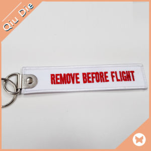 Custom Embroidery Remove Before Flight Textile Keychain pictures & photos