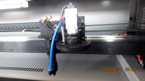 CCD Laser Cutting Machine for Label with Camera Flc1610 pictures & photos