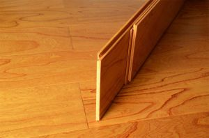 Light Embossed Laminate Wood Flooring pictures & photos