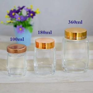 Square Shape Glass Honey Storage Bottle with Gold Lid pictures & photos