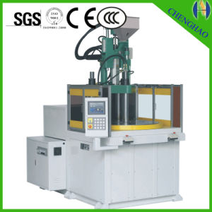 New Vertical Rotary Table Injection Molding Machine pictures & photos