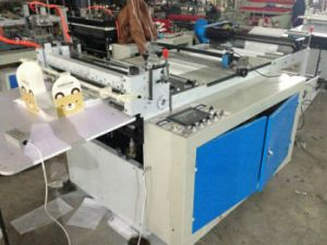 PVC Pet Film Roll to Sheets Computer Cutting Slitting Machine (HQ500-1200) pictures & photos