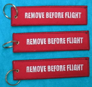 Cheap Customized Remove Before Flight Keychain pictures & photos