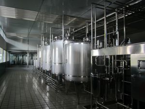 Full Automatic Food Sanitary Pasteurized Milk Processing Line pictures & photos