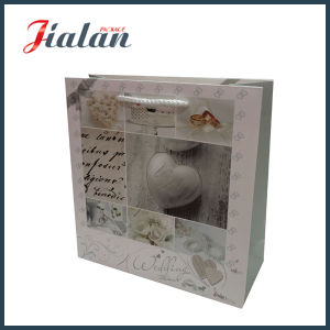 Wedding Design Custom Logo Printed Cheap Paper Carrier Bag pictures & photos