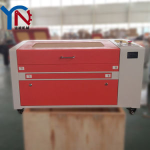 Wood Acrylic Nonmetal CO2 Laser Cutting Machine Price (YN-6040) pictures & photos