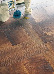 8.3mm E1 HDF Wood Art Parquet Laminated Flooring pictures & photos