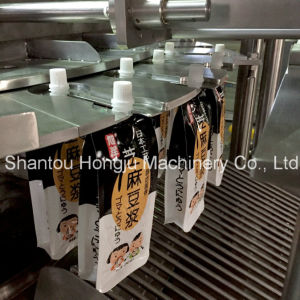 Filling and Capping Machine for Spouted Pouch pictures & photos