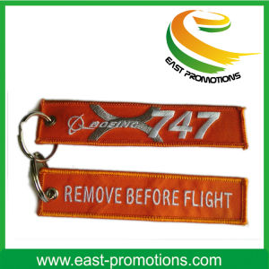 Custom Cheap Embroidery Fabric Remove Before Flight Key Chain pictures & photos