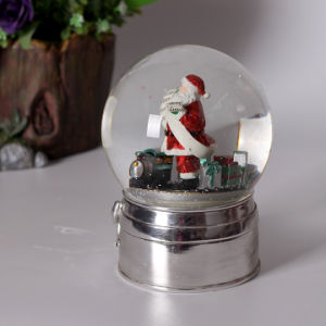 High Quality Resin Xmas Snow Globe with Silvery Base pictures & photos