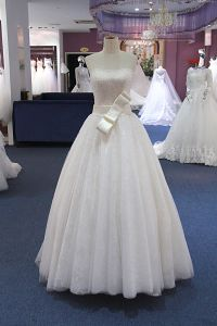 A Line Beading Wedding Dress with Strapless Neckline pictures & photos