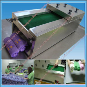 Hot Selling High Quality Automatic Towel Rolling Machine pictures & photos