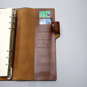 Leather Notebook with Pocket on The Back Cover pictures & photos