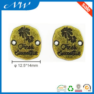 Various 2 Hole Plated Metal Badge Alloy Label pictures & photos