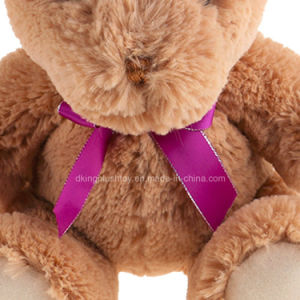 Imported Plush Stuffed Animals Teddy Bear with a Purple Bow pictures & photos