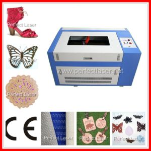Laser Engrave and Cutting Machine for Wood/Cloth/Leather 40W 50W pictures & photos