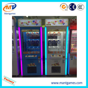 Toy Claw Crane Machine Coin Operated Game Key Master Machine pictures & photos