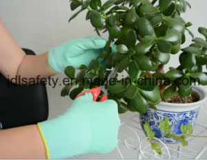 Polyester Knitted Work Glove with Smooth Nitrile Dipping (N1561) pictures & photos