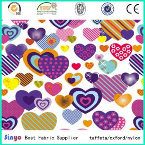 100% Polyester Bags Luggage Heart Printing Fabric with PVC Backing pictures & photos